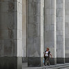 High columns reaching with person walking  at the Russian State Library in Moscow Russia