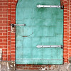 Old green steel iron door and red clay brick wall of Cathedral St. Vasily the Blessed (Saint Basil's)