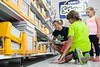 Nikki Shrader and her children, 5th grader Ryan and preschooler Shyanne, hunt for required school supplies at WalMart.