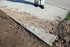 The entrance to the Outlet Shoppes of the Bluegrass has a turn so tight that delivery drivers often wind up on the sidewalk near Culver's. The freshly laid sod and irrigation system have already been damaged to the point of needing repair.