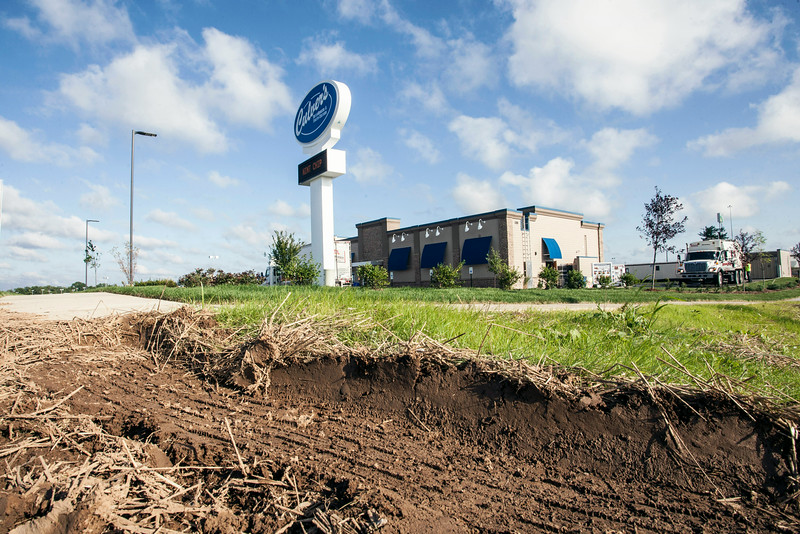 The heavy traffic of big rigs making deliveries to the Outlet Shoppes of the Bluegrass has left deep tread marks in the freshly landscaped sod of Culver's.