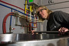 Leah Dienes puts in work behind the scenes at Apocalypse Brew Works Saturday night. Her crew of award-winning brewers have over 40 years combined experience in the craft according to their website. 12/13/14