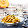 Penne with pumpkin-sage sauce, crispy bacon and amarettini crumbs