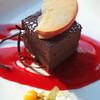 CANADA-Alberta-Banff-Banff National Park-Lake Louise-Deer Lodge-Chcocolate cake with apple slices and rasberry sauce