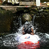 BALI. TIRTA EMPUL TEMPLE. BALINESE PEOPLE TAKE A PURIFYING BATH.