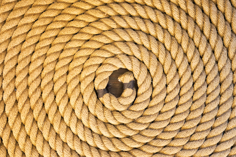 Coiled - Rope is coiled on the deck of the U.S.S. Constitution, the oldest commissioned warship in the Navy, dating back to the 1700's.