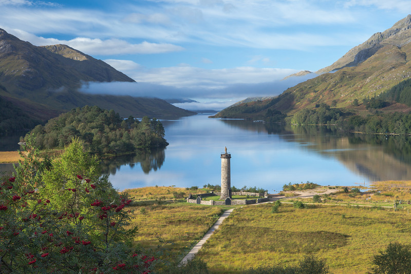 "GLENFINNAN MONUMENT Bonnie Prince Charlie arrived here in August 1745 to lead ""the '45 Jacobite Rising"". Loch Shiel, Highlands, Scotland"