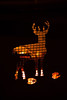 A deer silhouette on the side of a metal fire pit.