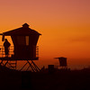 After packing up and lugging my equipment  back across the large sand area of Huntington Beach Ca. I look over and saw the Lifeguard enjoying the beautiful light show.. Got goosebumps over the silhouette and to unpack very quickly to capture this... our job is never done..