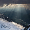 Evening rays of light reach down from the Glacier des Bossons to the bottom of Chamonix Valley. A fantastic view from the Refuge des Cosmiques at 3613m on the Mont Blanc Massif during the Arct'eryx Alpine Arc'ademy.