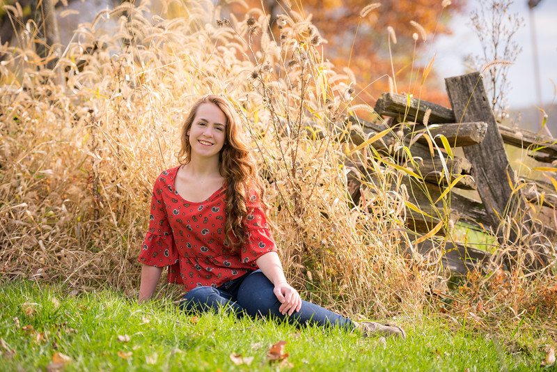 A nice senior photo using the natural environment as part of the composition.