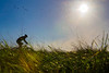 Mountain biker in grassy field.