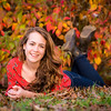 A senior photo with lots of fall colors.