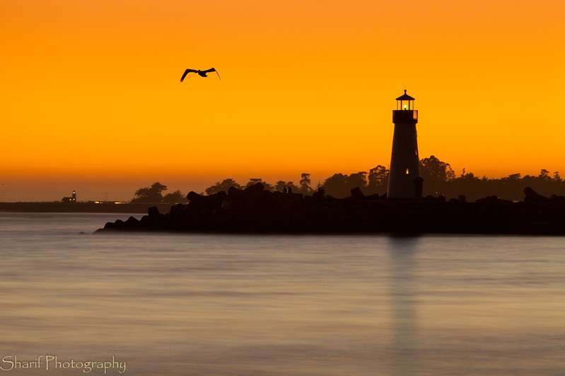 Both of Santa Cruz's lighthouses in the setting sun.