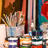 Collection of oil paints and brushes in artists studio workshop