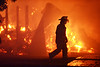 Joe Ellis/The Clarion-Ledger<br /> A firefighter walks past the blazing remains of a barn at the Mississippi Agriculture and Forestry Museum in Jackson. Buildings at the museum caught fire late Thursday afternoon.<br /> A firefighter walks past blazing wreckage of a barn at the Mississippi Agriculture and Forestry Museum that caught fire late Thursday afternoon.