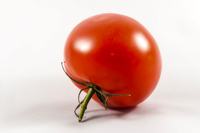 red Tomato isolated on white background.