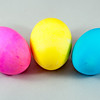 three easter eggs pink  blue yellow