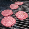 tasty beef burgers on the grill