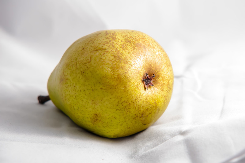 yellow ripe pear isolated on white background