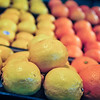 lemon and oranges on produce shelf