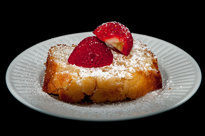 pound cake with strawberry on black