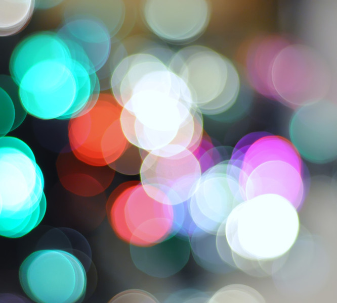 Blurred christmas lights background. De focused Light