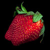 fresh red strawberry isolated on a black background