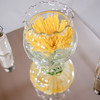 Yellow flowers in glass bowl with salt and pepper