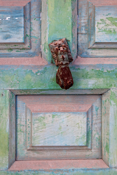Metal knocker on old wooden door