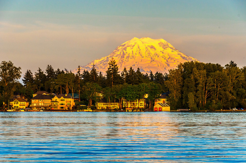 Mt Rainier at Sunset.    Mt Rainier glows orange in the light of the setting sun.
