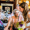 A few generations coming together at a bridal shower, some chatting, some just being proud.