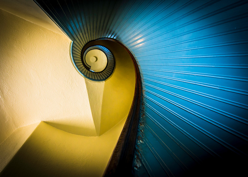 The spiral staircase inside the Point Loma lighthouse at Cabrillo National Monument in San Diego, California.