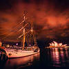 "<h2>Awesome Ship in Sydney Harbor</h2> <br/>Tom and I walked down to the Rocks one night, which is one of the oldest parts of the Sydney Harbor. I was wondering, actually, if I should spell it ""harbour"" now that I live down thisaway. I do like the British spellings of things… they seem so much more… well, British and sophisticated. I guess I'll just stick with ""harbor"" – I don't want people thinking I've turned native so quickly.<br/><br/>Anyway, the ship was moving a lot in the sea, so I had my ISO up pretty high to compensate. Usually, what I'll do in this situation is take a normal set of brackets at a low ISO to get a nice HDR shot, and then I'll take another at high ISO to freeze the movement… and then I do my best to Frankenstein it all together.<br/><br/>- Trey Ratcliff<br/><br/><a href=""http://www.stuckincustoms.com/2013/04/10/awesome-ship-in-sydney-harbor/"" rel=""nofollow"">Click here to read the rest of this post at the Stuck in Customs blog.</a>"