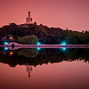 "<h2>Beihei Park Island in Beijing</h2> <br/>It was a beautiful and still night when we arrived. This park is quite huge and it can take well over an hour to walk around the whole island, so there wasn't a lot of time to catch a good location for the setting sun. Luckily, Tom had been to this spot before, so we were able to quickly get in position. Good sunsets are really rare in Beijing because of all the smog, but this evening came out nicely because of a strange pink-purple light that burned through the smog/fog as the sun set. <br/><br/>- Trey Ratcliff<br/><br/><a href=""http://www.stuckincustoms.com/2013/06/13/baihei-park-island-in-beijing/"" rel=""nofollow"">Click here to read the rest of this post at the Stuck in Customs blog.</a>"