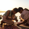 Two Vedic students light a prayer candle to release into the Ganges River in Varanasi, India