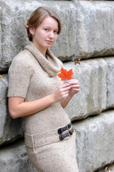holding a fall leaf