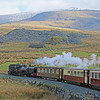 The Welsh Highland's former South African Railways' No 87 climbs into the Snowdon foothills with the 10:45 Porthmadog to Caernarfon service.    26/03/2014.