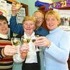 Celebrating 21 years at Glin Credit Union. From left: staff members Emer Ward and Mary Healy, chairman John Healy and manager Kathy O Sullivan.<br /> pic: Manuela Dei Grandi/Landy Photo