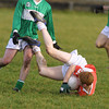 Ballydonoghues Anthony O connor  watches Brosnas  Don McAuliffe hit the deck hard with ball in Hand. Pic Brendan Landy