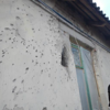 Damaged house due to fighting.<br /> <br /> The NRC Emergency Response Team arrived in Ukraine at the end of October 2014. Immediately it was identified that the biggest needs are in the Eastern two Oblast's (administrative divisions) of Dontesk and Luhansk. <br /> <br /> After initial visits to the government held territories within these Oblasts and discussions with partners and other humanitarian authorities the NRC team has decided to establish a base in Severodonetsk town of Luhansk Oblast. This area hosts IDPs and is close to population affected by conflict and the frontline itself.<br /> <br /> NRC has managed to reach the town of Shastia and delivered rebuilding materials to city authorities who distributed it to vulnerable people. NRC staff are now working with local authorities and providing materials to local electrical and gas companies in their efforts to restore power and gas supplies to affected towns and villages at front line.<br /> <br /> Photo: NRC/Zoran Filipovic