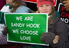 """We are Sandy Hoor. We Choose Love"". Wearing the green and white colors of Sandy Hook Elementary School where 26 children and adults were killed, 100 residents from Newtown, Connecticut joined thousands of other gun-control activists on Saturday, January 26, 2013 in Washington D.C. in a march down Constitution Ave. to a rally with speeches, musical performances and a poetry reading near the Washington Monument. (Photo by Jeff Malet)"