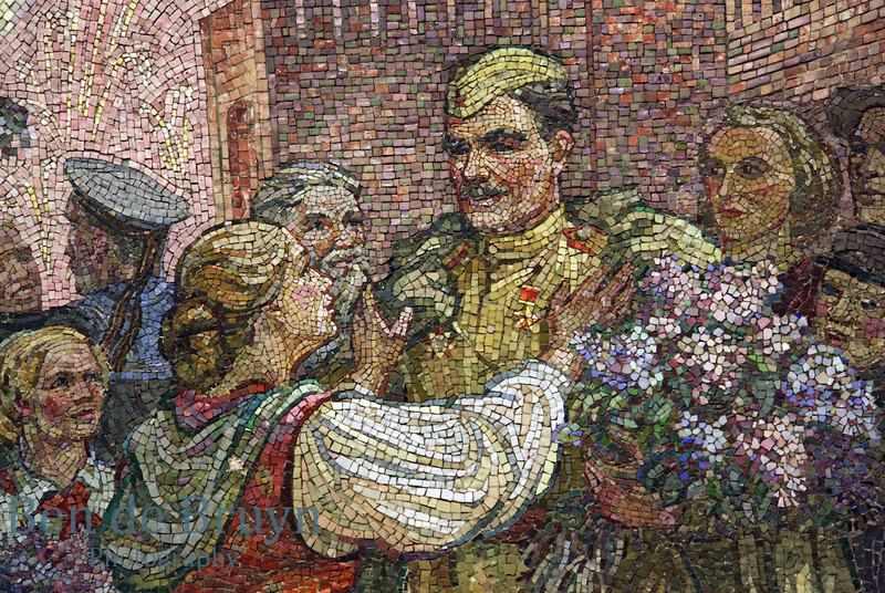 Kiyevskaya metro station Moscow Russia with mosiac wall of small tiles celebrating war victory with people of Ukraine