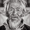 Tibetan man at Ngor Monastery restaurant near Shigatse