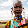 Portrait of a Maasai woman at her home camp in the Upper Mara, Kenya