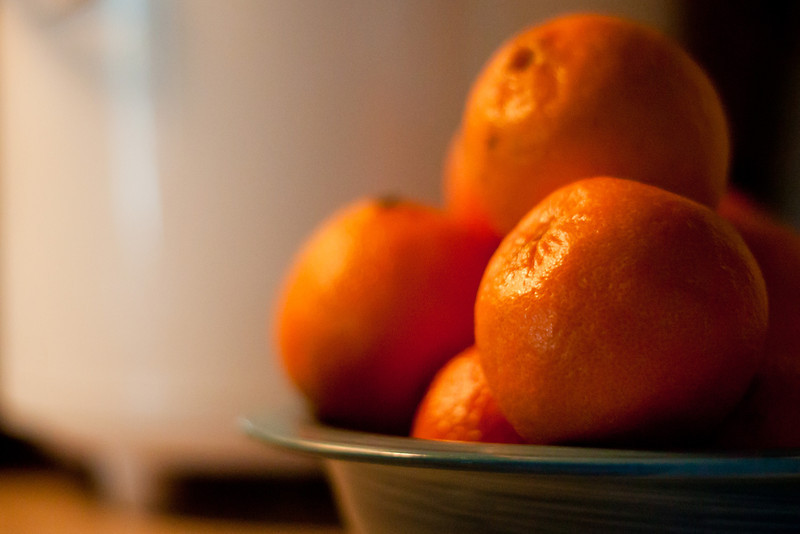 Day 235 Clementine Oranges  I'm watching Photoshop for Photographers with Ben Willmore at CreativeLIVE.  It's fabulous and I was inspired to do some post processing.  Manual  50mm  ISO1600  1/125sec  f/1.8