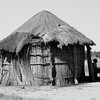 A BaYei man sids outside his home in Jedibe, Okavango Delta, Botswana