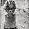 Tibetan woman outside her home near Shigatse