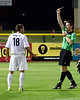 Referee Lucian Radoslovescu displays the red card to Sacramento Republic's Ivan Mirkovic during the 90th minute of play.