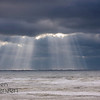 Streaming Sunlight through Dark Clouds Seascape